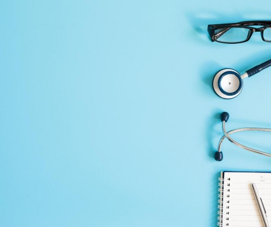 Blue screen with glasses, stethoscope and notepad